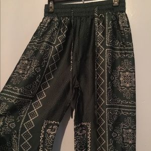 Green and black silk loose trousers